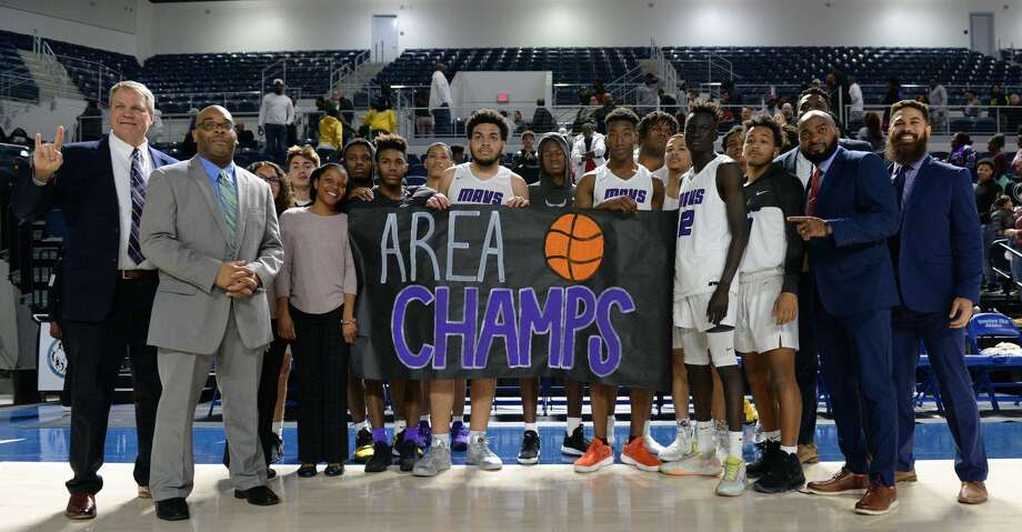 The Morton Ranch Mavericks celebrate their 71-51 victory over the Sam Houston Tigers in a Boys 6A Region III Area round play-off game on Thursday, February 27, 2020 at Delmar Fieldhouse, Houston, TX. Photo: Craig Moseley/Staff Photographer