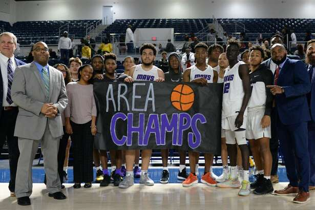 The Morton Ranch Mavericks celebrate their 71-51 victory over the Sam Houston Tigers in a Boys 6A Region III Area round play-off game on Thursday, February 27, 2020 at Delmar Fieldhouse, Houston, TX.