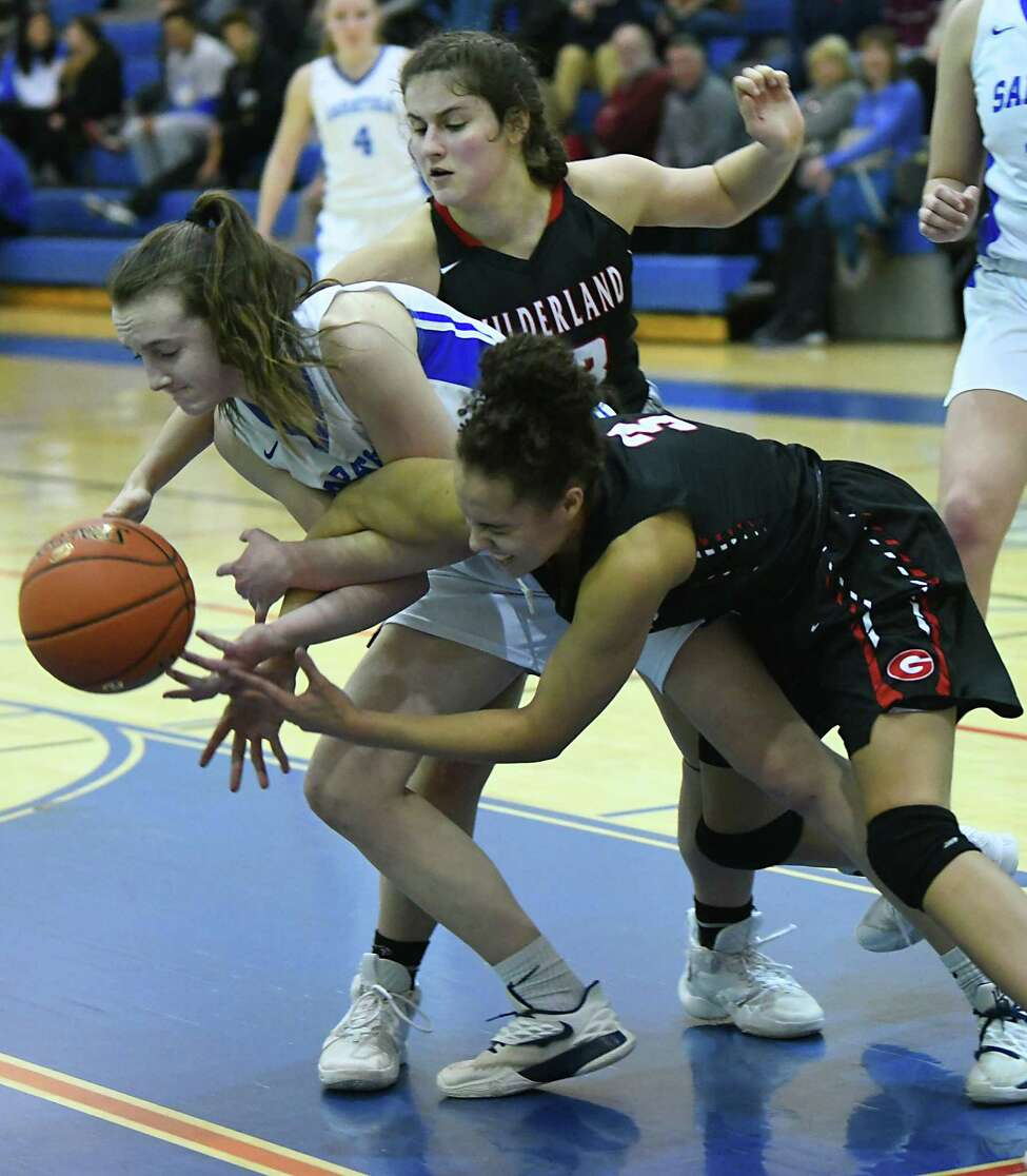 Guilderland's Valencia Fontenell-Posson battles against Saratoga's Katie Claeson during a game on Thursday, Feb. 27, 2020 in Saratoga Springs, N.Y. (Lori Van Buren/Times Union)