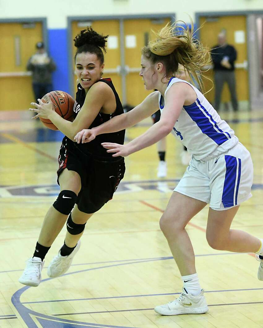 Guilderland's Valencia Fontenell-Posson drives to the basket against Saratoga's Abby Ray during a game on Thursday, Feb. 27, 2020 in Saratoga Springs, N.Y. (Lori Van Buren/Times Union)