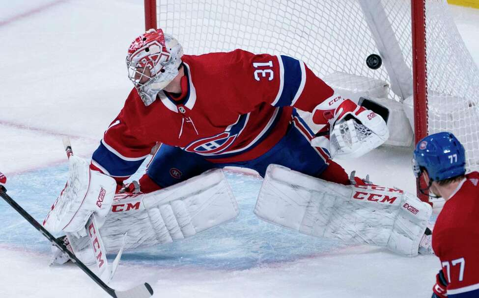 The puck goes into the net past Montreal Canadiens goaltender Carey Price for a goal by New York Rangers' Mika Zibanejad during the third period of an NHL hockey game Thursday, Feb. 27, 2020, in Montreal. (Paul Chiasson/The Canadian Press via AP)