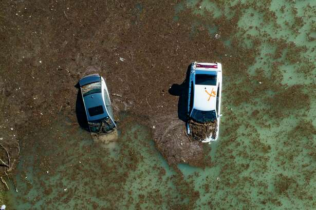 Water is slowly draining from the freeway after a water main break east of the location flooded all lanes, closing the freeway in both directions, Thursday, Feb. 27, 2020, at the intersection of 610 and Clinton Drive in east Houston. Businesses and schools shut down Thursday after a main line from a plant that supplies water to about half of Houston burst open, submerging vehicles on a flooded freeway and prompting emergency officials to deploy tanker trucks to mitigate any fire hazards. (Mark Mulligan/Houston Chronicle via AP)