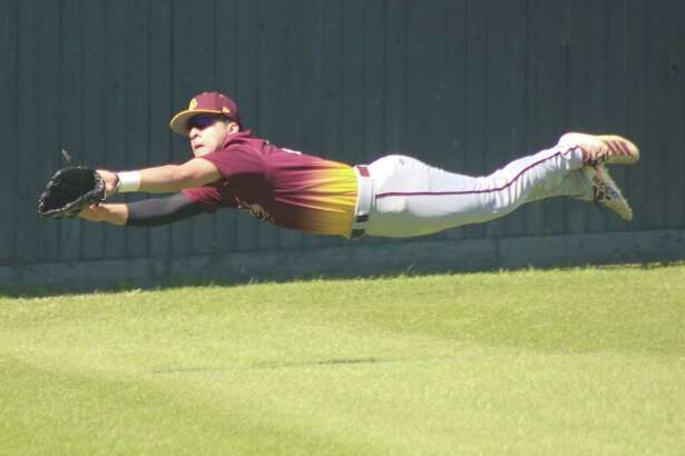 Deer Park left fielder Anthony Solano attempts a diving catch of a foul ball during the Clear Lake game Thursday afternoon.