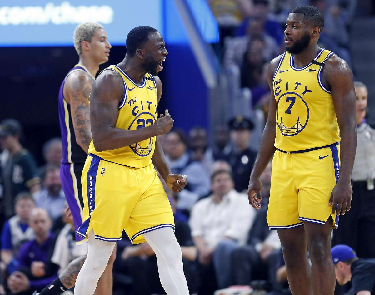 Golden State Warriors' Draymond Green reacts to being ejected as Eric Paschall looks on in 2nd quarter against Los Angeles Lakers in NBA game at Chase Center in San Francisco, Calif., on Thursday, February 27, 2020.