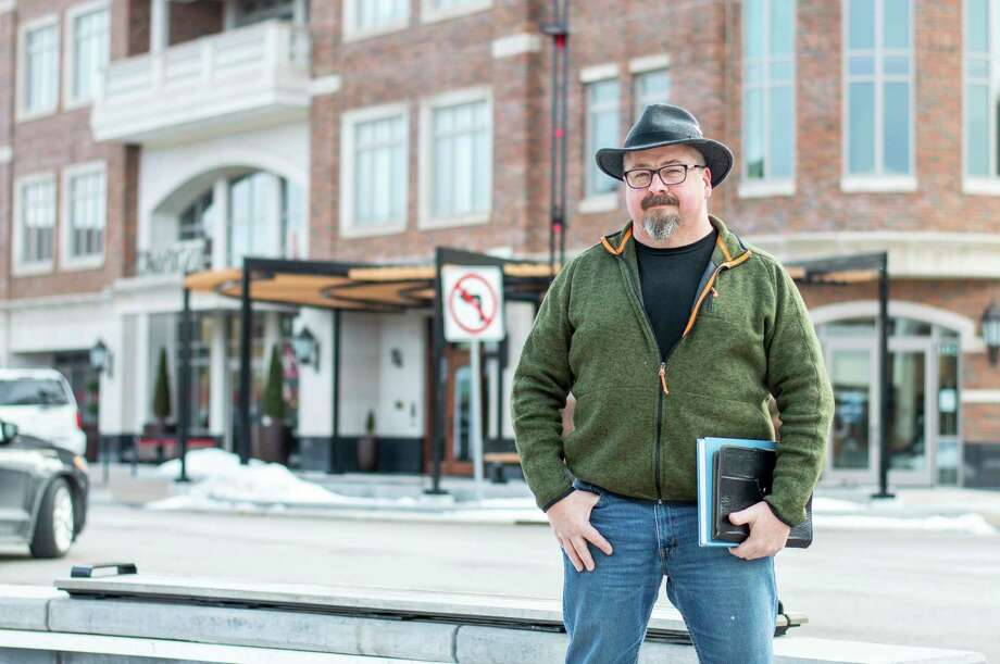 Eric Larsen poses for a portrait in downtown Midland. (Andrew Mullin/for the Daily News)