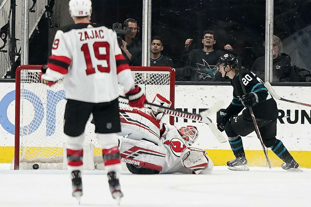 San Jose Sharks left wing Marcus Sorensen (20) scores a goal past New Jersey Devils goaltender Cory Schneider during the second period of an NHL hockey game Thursday, Feb. 27, 2020, in San Jose, Calif. (AP Photo/Tony Avelar)