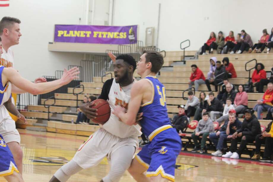 Ferris' men's basketball team defeated Lake Superior State 84-67 in Thursday's regular-season finale to earn the top seed in the GLIAC playoffs. Photo: John Raffel