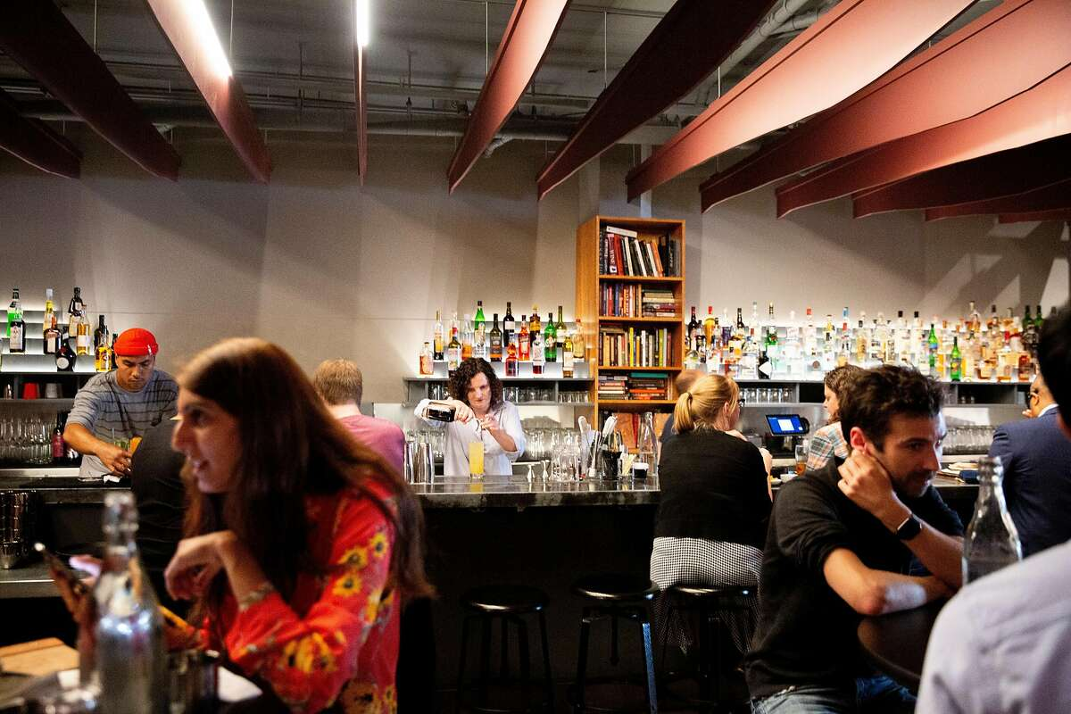 Bar owner Jennifer Colliau makes a Here�s How cocktail at Here's How, Thursday, Aug. 1, 2019, in Oakland, Calif. The bar is located at 1780 Telegraph Ave.