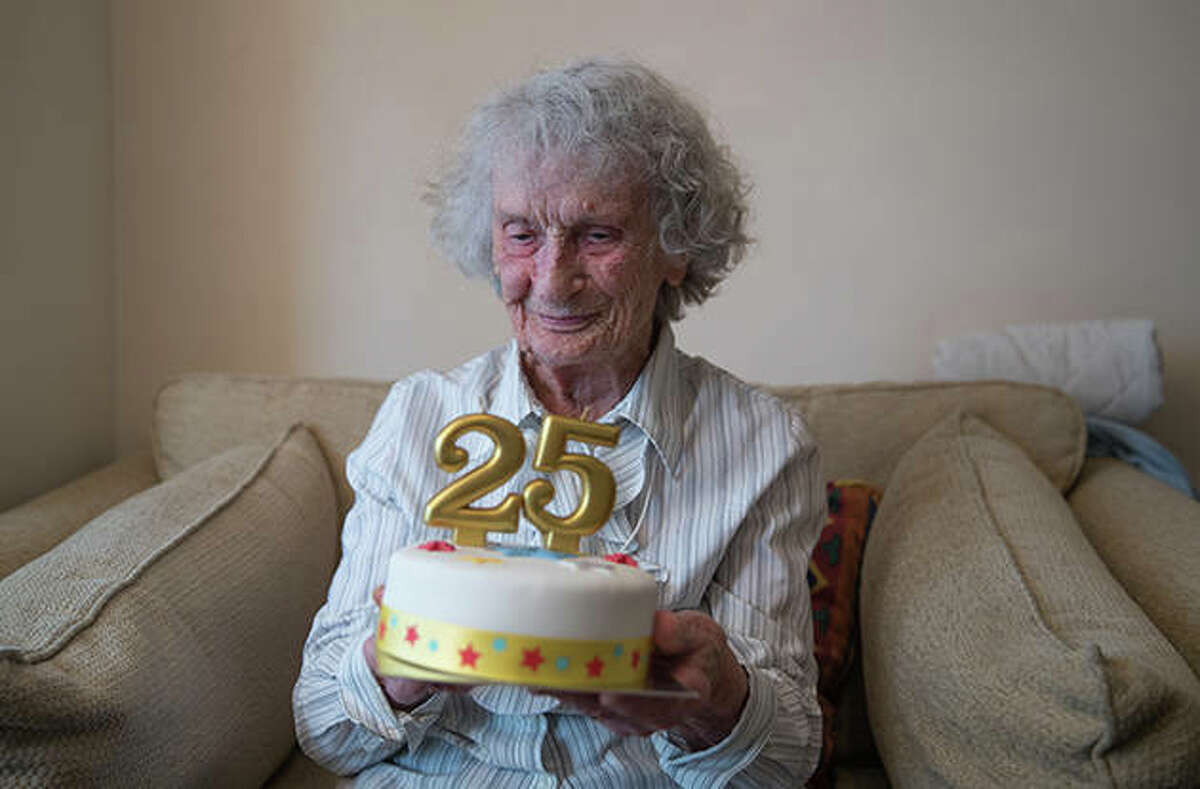 Great-great-grandmother Doris Cleife holds a birthday cake with candles showing the number 25 as she prepares to turn 100 years old on Saturday, though it is only the 25th time Doris has been able to celebrate her birthday due to being born during a leap year.