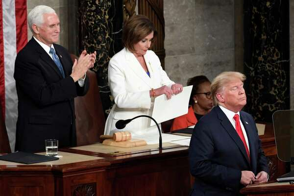 House Speaker Nancy Pelosi, D-Calif., tears her copy of President Donald Trump's s State of the Union address after he delivered it to a joint session of Congress on Capitol Hill in Washington, on Tuesday, Feb. 4, 2020. Vice President Mike Pence applauds at left. (AP Photo/Susan Walsh)