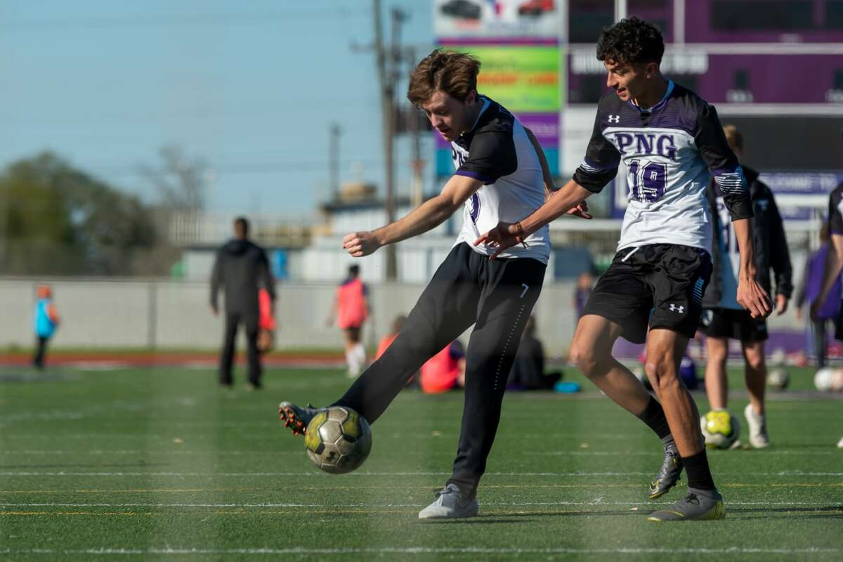 Jason Lovejoy (7) puts the ball in the net around Reyes Gonzalez (19) during drills as the Port Neches-Groves Indians boys soccer team practices at the school on Thursday, February 27, 2020. Fran Ruchalski/The Enterprise