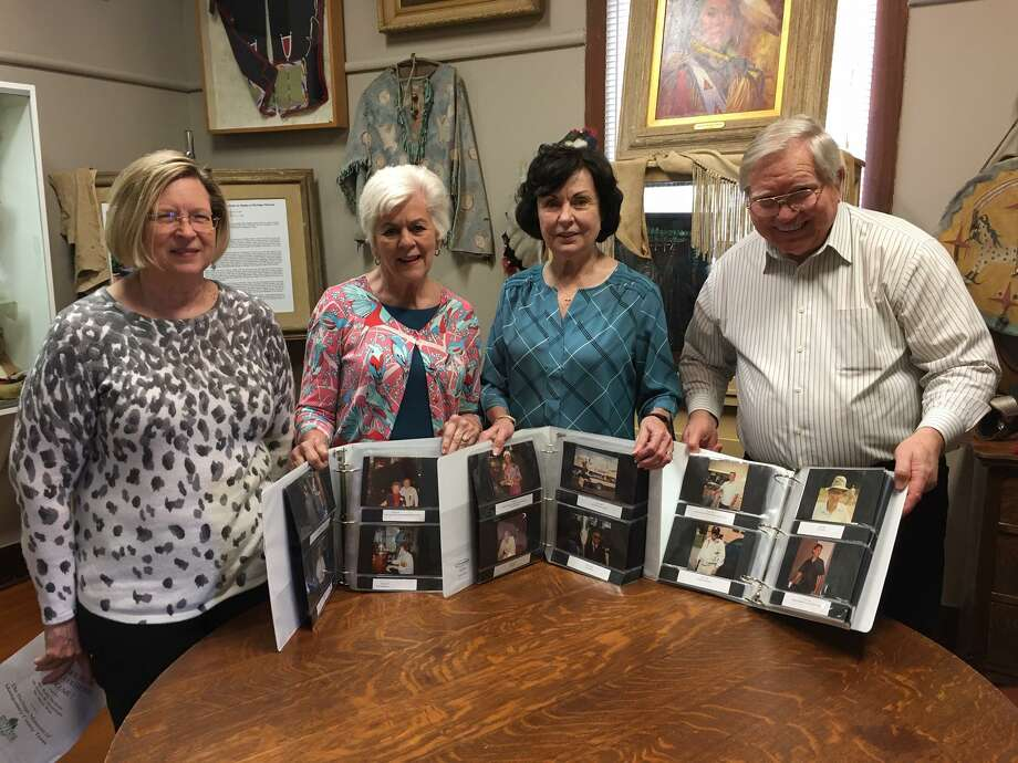 Pictured from left are Karen Kelley, niece of Chester B. Kelley, and the members of the Heritage Museum's Special Project Committee including Merry Wise, Robin Bartholet and Emery Heuermann. Chester Kelley had about 1,500 photos he took from 1966 to 2002 in Conroe. Following his death in 2004, his family donated his photos to the Heritage Museum. Since 2014, Wise, Bartholet and Heuermann have spent time organizing the photos into albums and identifying and cataloging them. Photo: Photo By Sondra Hernandez