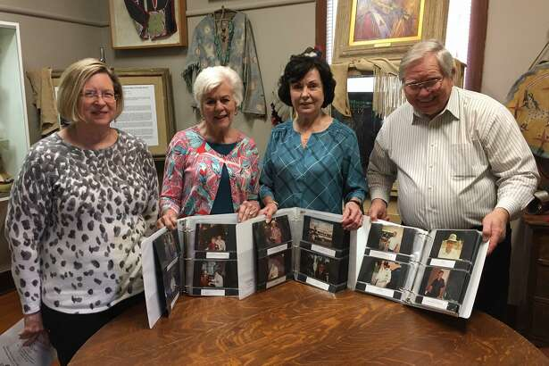 Pictured from left are Karen Kelley, niece of Chester B. Kelley, and the members of the Heritage Museum's Special Project Committee including Merry Wise, Robin Bartholet and Emery Heuermann. Chester Kelley had about 1,500 photos he took from 1966 to 2002 in Conroe. Following his death in 2004, his family donated his photos to the Heritage Museum. Since 2014, Wise, Bartholet and Heuermann have spent time organizing the photos into albums and identifying and cataloging them.