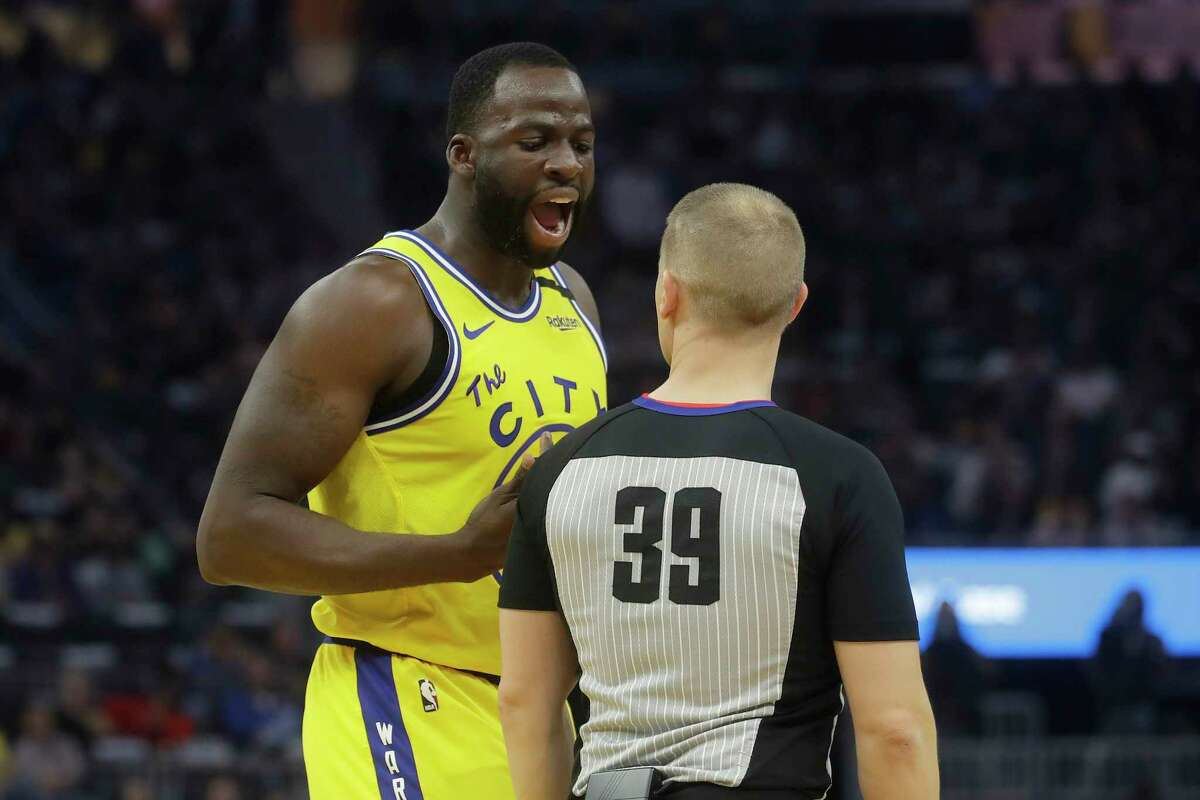 Golden State Warriors forward Draymond Green, left, argues with referee Tyler Ford during the first half of an NBA basketball game between the Warriors and the Los Angeles Lakers in San Francisco, Thursday, Feb. 27, 2020.