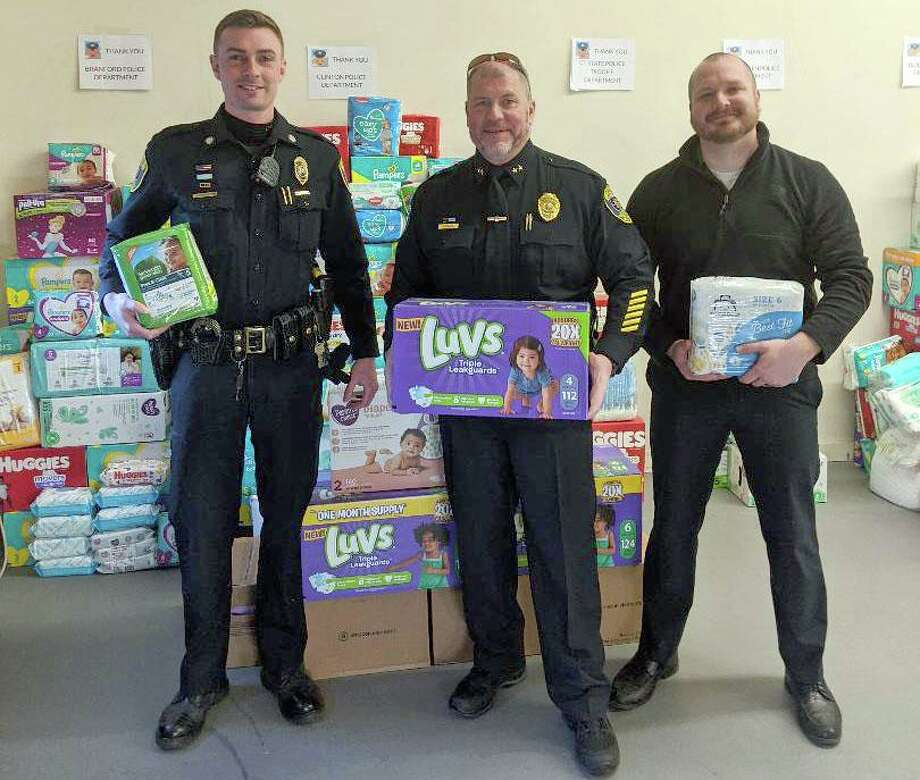 The Clinton Police Department, along with other Shoreline law enforcement agencies, partnered with Bare Necessities, Inc. to collect diapers and wipes for local families in need. Pictured here (from left to right) are Officer Spencer Mangs, Chief of Police Vincent DeMaio and Officer Brian Corbin. Photo: Contributed Photo
