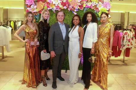 General manager Stephen Brunelle and the Chronicle's Amber Elliott, center, with models at the Neiman Marcus spring trends cocktail party on February 12, 2020 at Neiman Marcus in Houston.