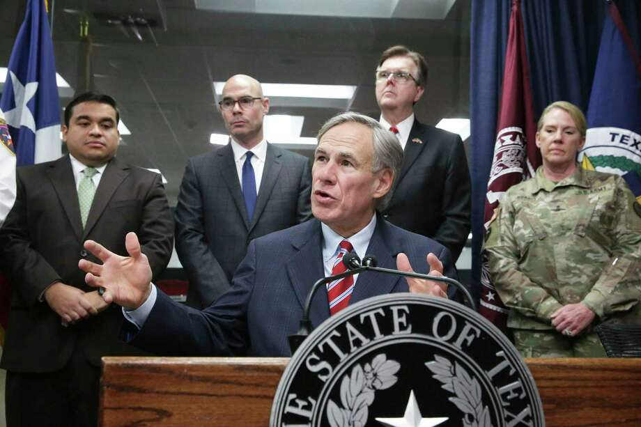 Governor Greg Abbott answers media questions as he and Lt. Governor Dan Patrick meet with public officials at the State Operations Center in Austin on Feb. 27, 2020. Although there have been no confirmed cases of coronavirus in Montgomery County, schools are preparing for the possibility. The risk locally remains very low, according to the Montgomery County Health Department. Photo: Tom Reel, San Antonio Express-News / Staff Photographer / **MANDATORY CREDIT FOR PHOTOG AND  SAN ANTONIO EXPRESS-NEWS/NO SALES/MAGS OUT/TV