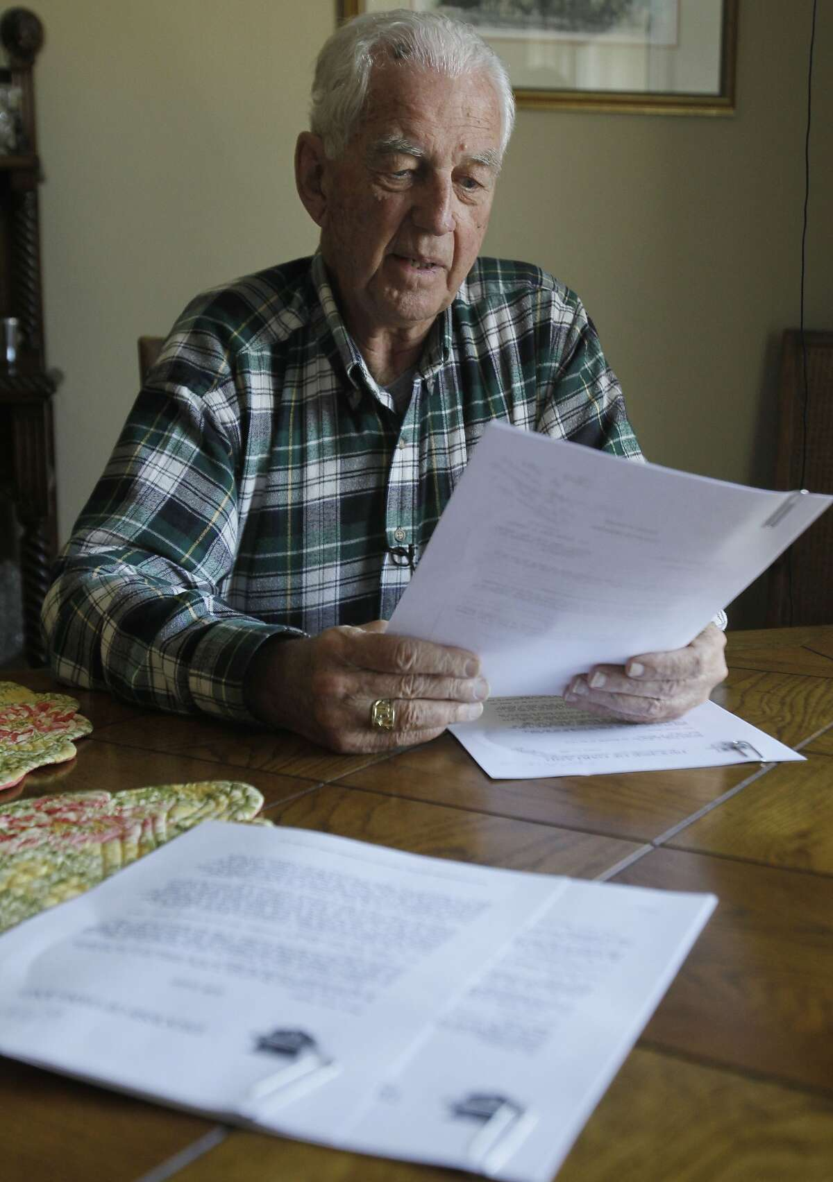 John S. Cummins, former bishop of the diocese of Oakland, Calif., recalls correspondence from Cardinal Joseph Ratzinger regarding troubled priest Stephen Kiesle as he looks over copies of a document brought by the Associated Press to his home in Oakland,
