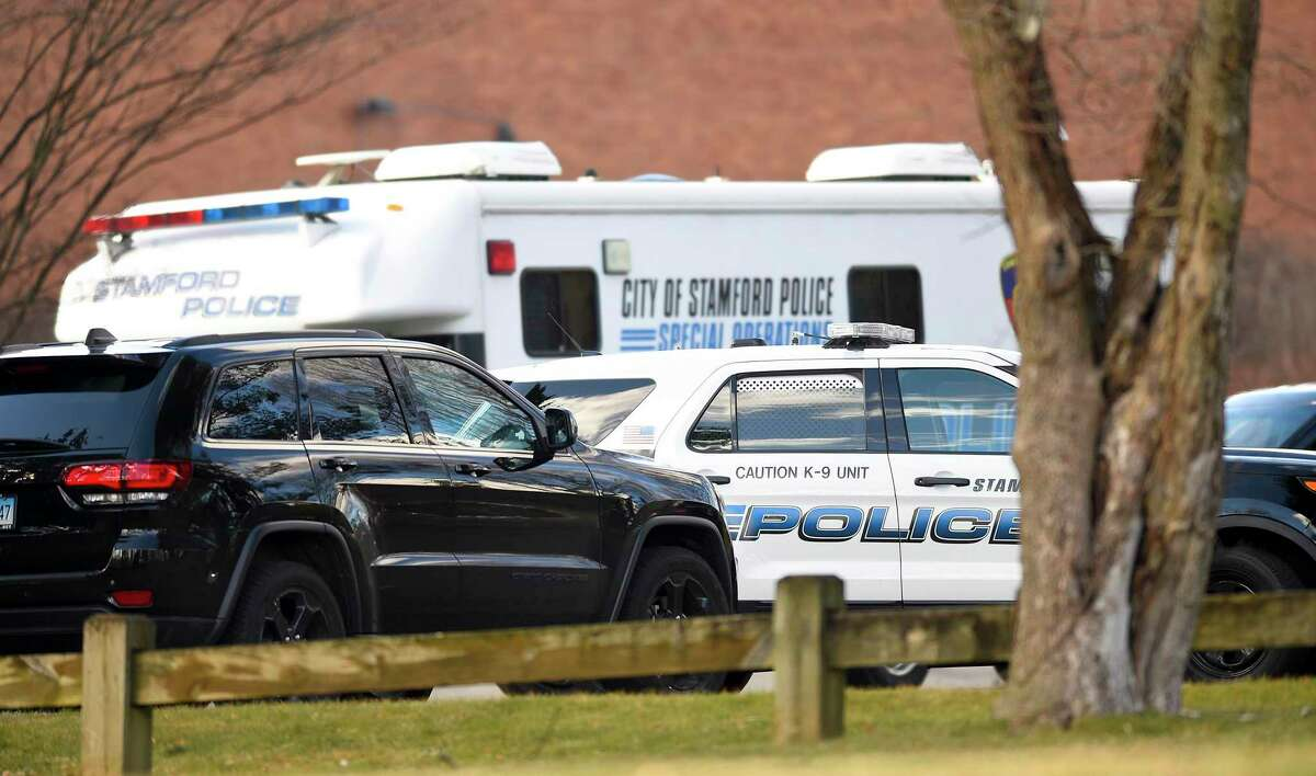 Stamford Police and emergency responders shutdown Newfield Avenue near Trinity Catholic High School in Stamford, Conn. on Feb. 27, 2020. Reports of an incident involving an active shooter at a nearby residential home drew a heavy police presence, causing the high school to shelter in place. The initial call was determined to be a hoax, police said.