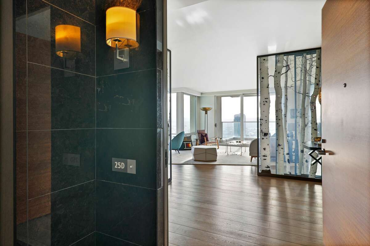 A luxe bird's nest with a $9.8M price tag, this St. Regis condo is oversized and opulent.