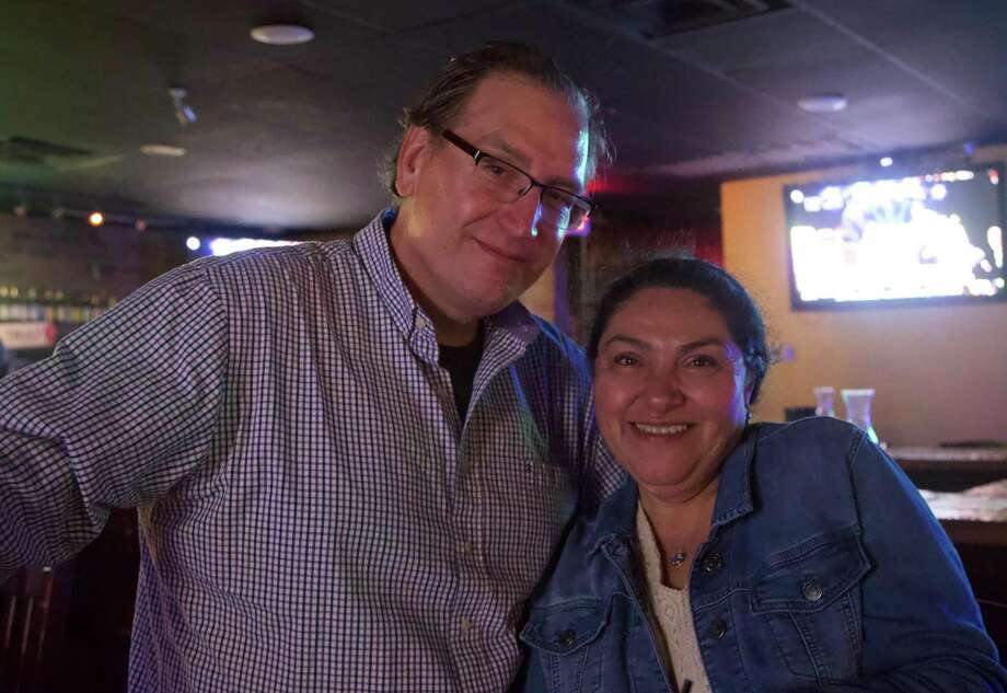 Jeff Greenwell and Patricia Greenwell are at McFinnigan's Pub. Photo: Xelina Flores /For The Express-News