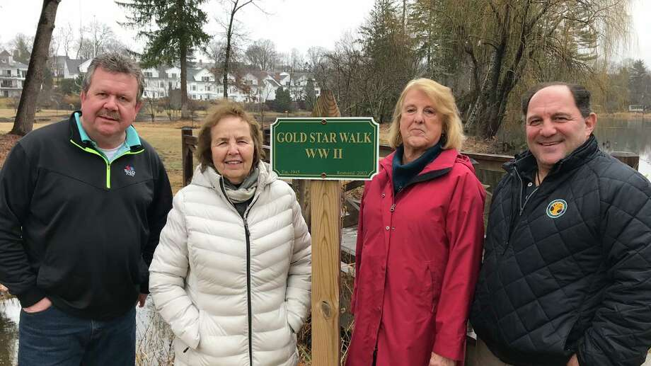 Department of Public Works Highway Superintendent Mose Saccary, New Canaan Beautification League Co-Presidents Karen Sneirson, and Barbara Beall and New Canaan Director of Public Works Tiger Mann pose for a photo at a stop on the Gold Star Walk in New Canaan's Mead Park. The Beautification League is seeking donations for its annual appeal. Photo: Contributed Photo