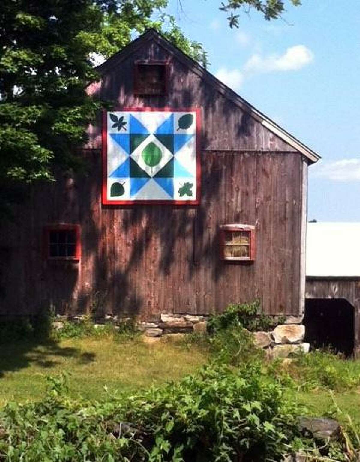 A quilt painting at 173 Ridge Rd in New Milford. New Milford will be the first Connecticut town to have a barn quilt trail - several barns with quiltlike painted patches on walls. The point of the endeavor is to bring attention to folk art and the towns agricultural roots.