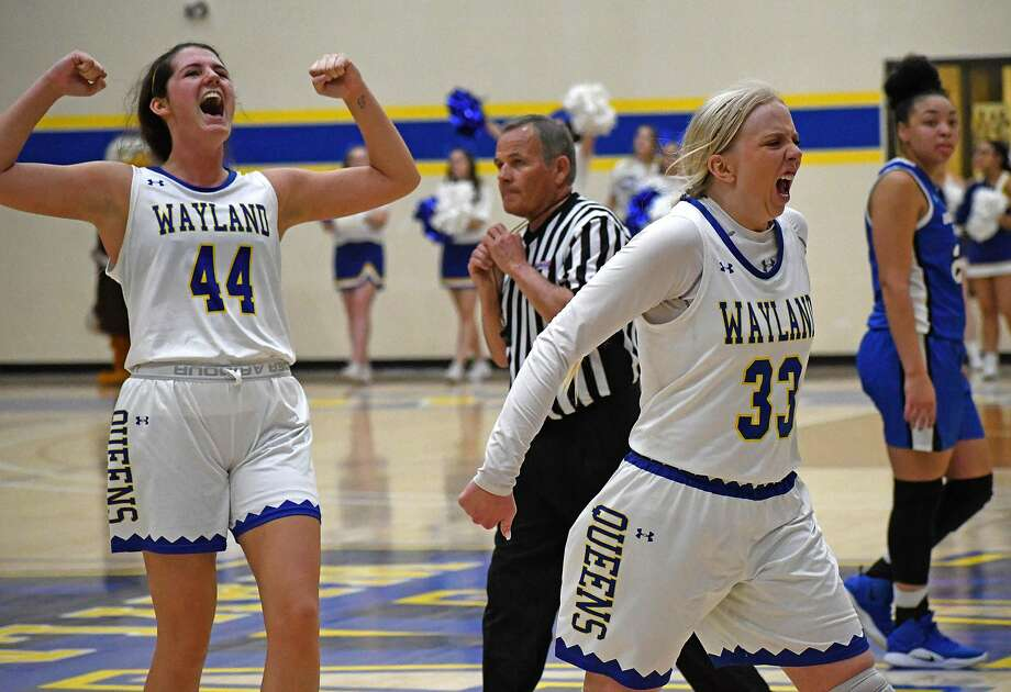 Wayland Baptist players Jenna Cooper (33) and Kelea Pool celebrate the Flying Queen's 65-50 win over top-ranked and undefeated Oklahoma City on Thursday, Feb. 27, 2020 in the Hutcherson Center. Photo: Nathan Giese/Planview Herald