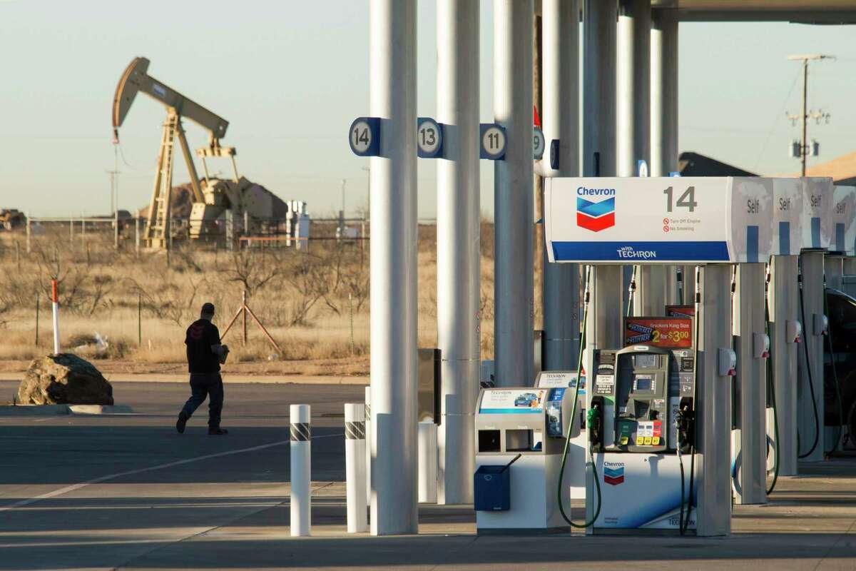 FILE -- A Chevron gas station near an oil pump jack in Midland, Texas, Jan. 29, 2016. (Michael Stravato/The New York Times)