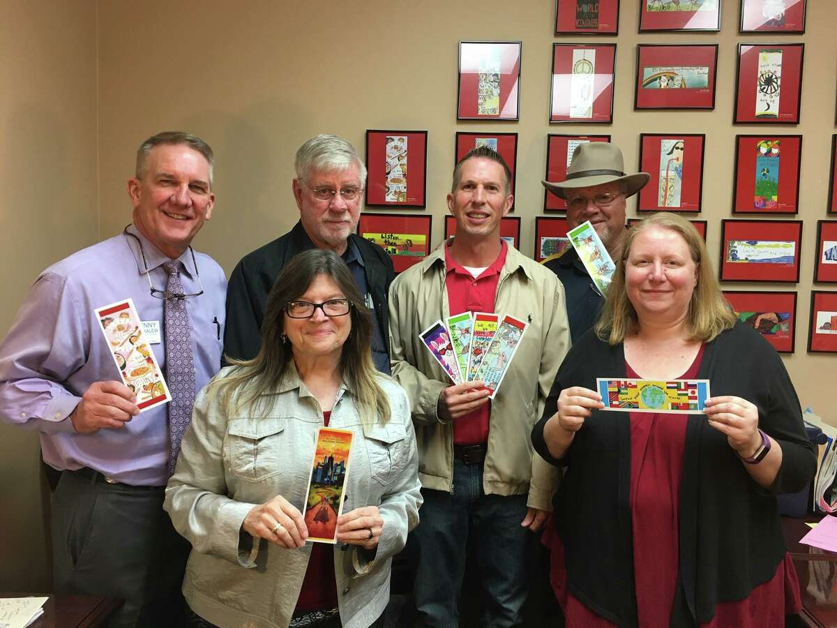 """Pictured at the DRC of Montgomery County offices Tuesday are from left, Club President Denny Buckalew, Board Member Kris Nordstrom McBride, Club Members Dave Bartlow, Chris Stamm and Ron Saikowski and Club Secretary Sondra Hernandez. The DRC gave 2,000 bookmarks to the Rotary Club of Conroe to use for their """"I Like Me"""" bookmark program."""