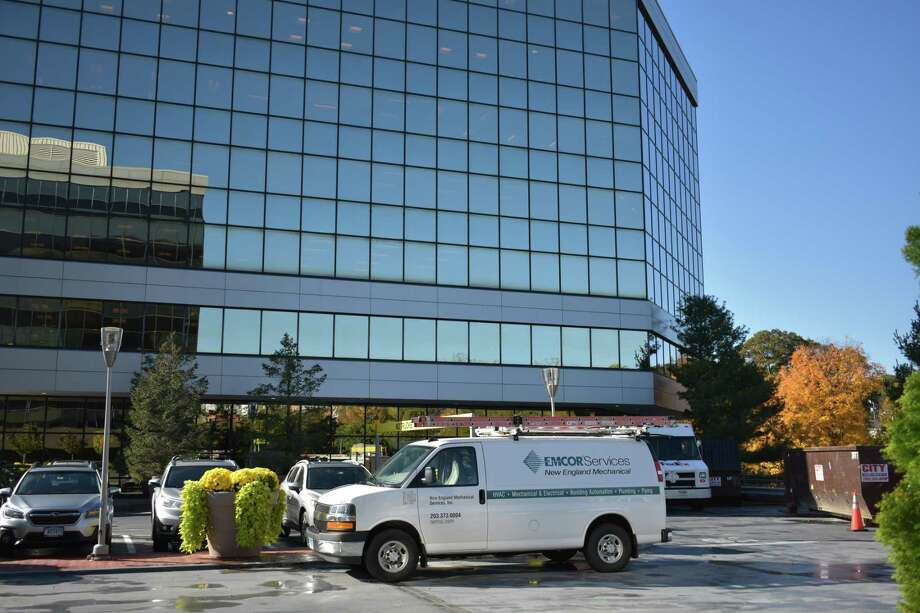 An Emcor service van outside the company's headquarters building in Norwalk, Conn. Photo: Alexander Soule/Hearst Connecticut Media / Hearst Connecticut Media