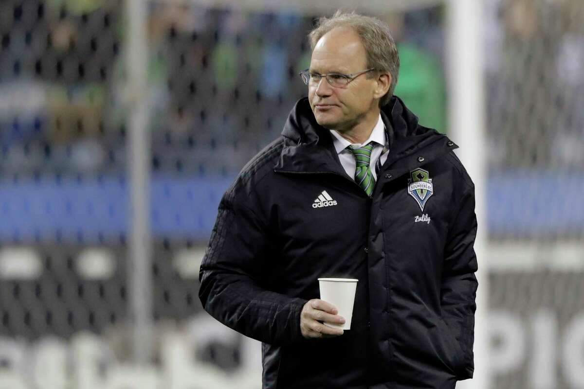 Seattle Sounders coach Brian Schmetzer walks on the field before a CONCACAF Champions League soccer match against Olimpia, Thursday, Feb. 27, 2020, in Seattle. The match ended with a 2-2 tie for a 4-4 aggregate score in the two-game series; Olimpia won on penalty kicks to advance to the next round.