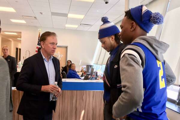 Gov. Ned Lamont is greeted by Harding High students Kevin Frank, a junior, and Nazjhir Curry, a senior. Bridgeport. Feb. 28, 2020