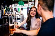 Cute couple having a drink in a bar