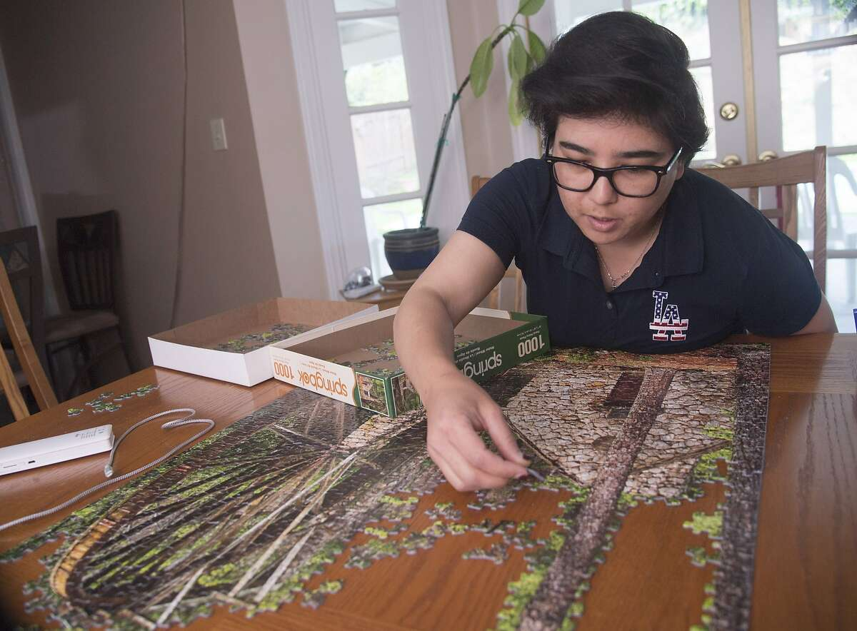 Hacienda Heights, CA - February 28, 2020 - LeighAnn Rorex spent time doing puzzles, chatting with friends on the internet and keeping up with the news while in quarantine at home in Hacienda Heights, California.