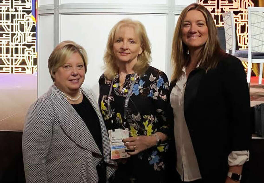 From left are Mary Schwartz Westerhold, Vice President and Chief Financial Officer at Madison Communications; Jill Kohlhaas, Heroism Award recipient and senior dispatcher at Madison Communications; and Amie Kassly, Kohlhass' daughter.