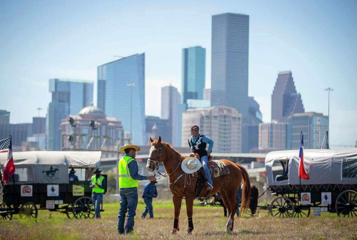 Riders with the Northeastern Trail Ride prepare to continue their ride after a lunch break on their final day of a seven-day-long trail ride that started near Beaumont, Friday, Feb. 28, 2020, in Houston.
