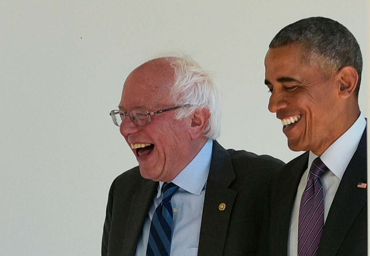 (FILES) In this file photo taken on June 9, 2016 US President Barack Obama (R) walks with Democratic presidential candidate Bernie Sanders through the Colonnade for a meeting in the Oval Office at the White House in Washington, DC. - For someone who has gone out of his way to stay off the political radar, Barack Obama could hardly loom larger over the bitter battle for the Democratic White House nomination. The 44th president of the United States has been quoted dozens of times in primary debates and starred (unwittingly) in campaign ads in the run-up to the South Carolina primary and Super Tuesday. (Photo by MANDEL NGAN / AFP) (Photo by MANDEL NGAN/AFP via Getty Images)