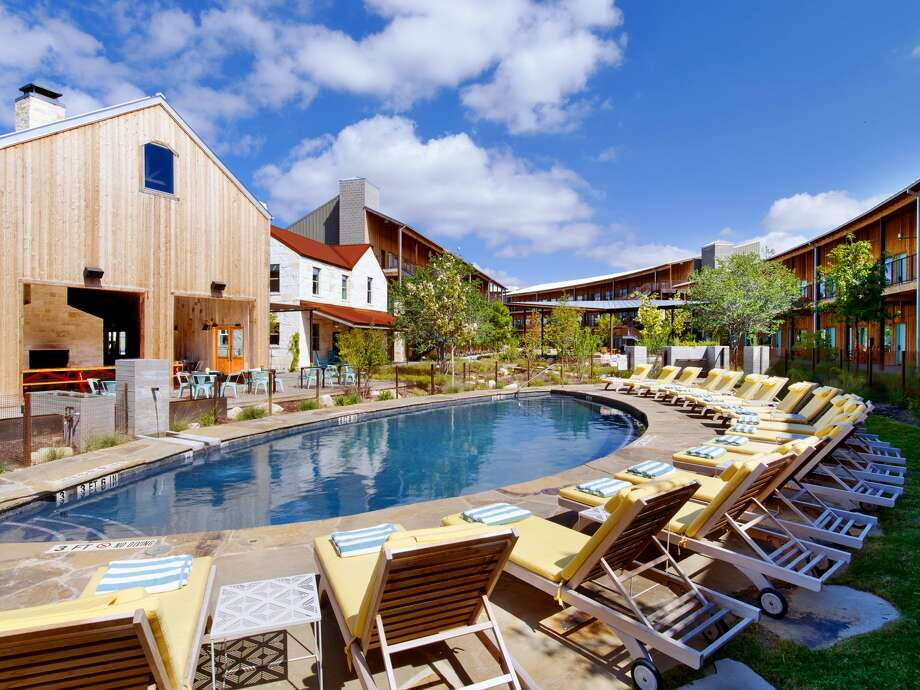 The boutique hotel features a guestroom fitness center and a pool reminiscent of an Austin swimming hole. Photo: Lone Star Court, Z Resorts