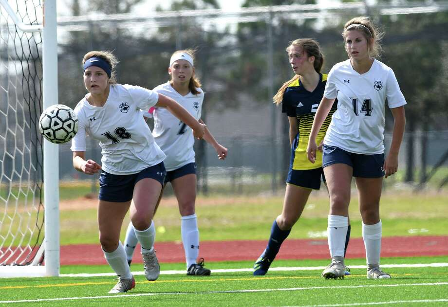 Tomball Memorial junior midfielder Abby Wilson (18) works the ball upfield against Cy Ranch during the 1st period of their District 14-6A matchup at CPHS on Feb. 15, 2020. Photo: Jerry Baker, Houston Chronicle / Contributor / Houston Chronicle