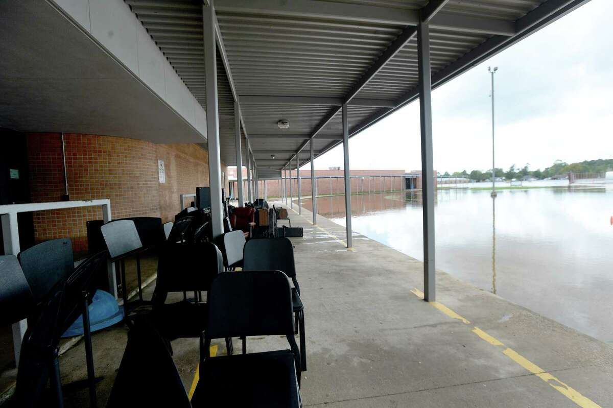 Band equipment sits outside to dry at Hamshire-Fannett Middle School, where every building on campus sustained flood damage from Imelda's heavy rainfall Thursday. District and school personnel were at the site evaluating the damage and meeting with contractors to begin the renovation process. School will be cancelled next week as they also formulate a plan for where students will go to continue classes this year. Photo taken Saturday, September 21, 2019 Kim Brent/The Enterprise