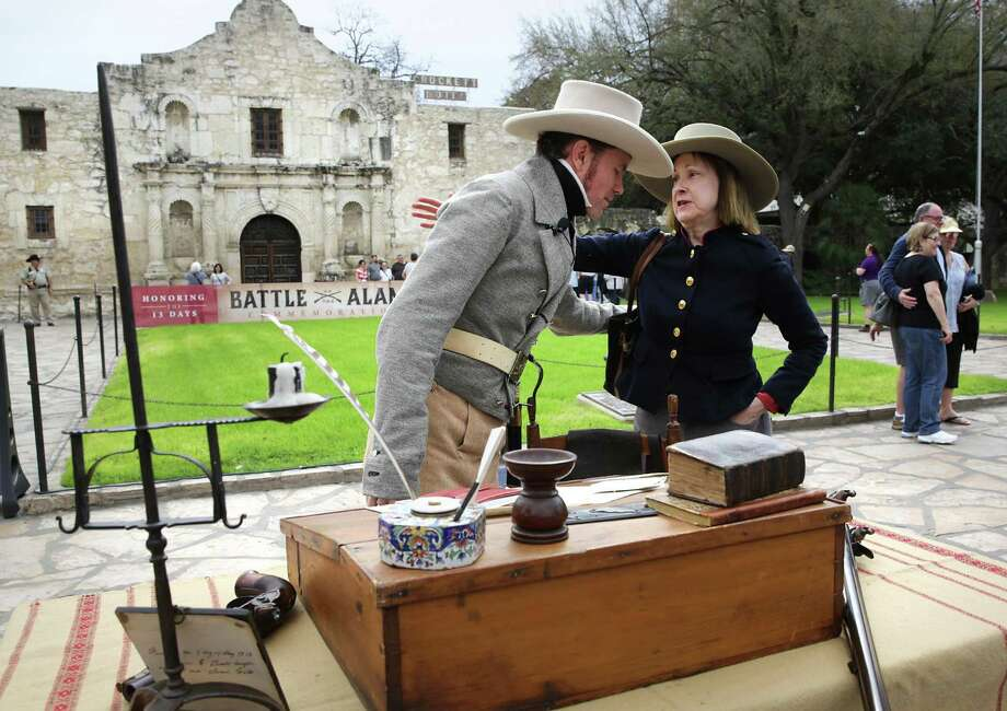 """Erik McBroom, left, portraiting William B. Travis, is greeted by Edith Pollitz of Tallahassee, Florida, who has studied and researched William Barret Travis for decades and wrote the book """"Victory or Death - Alamo Reprise during a re-enactment at the Alamo. Photo: Bob Owen / San Antonio Express-News / San Antonio Express-News"""
