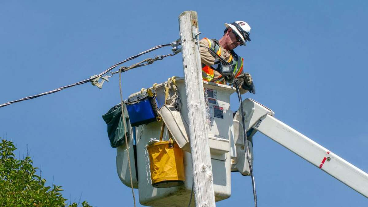 PG&E lineman, Vic Torino pull lines as a part of the routine repairs along Hall Road, Wednesday May 29, in Santa Rosa, CA.