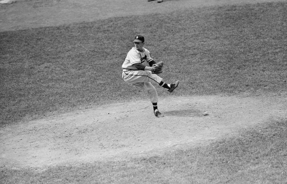 Boston Braves' Johnny Antonelli, 18-year-old pitcher, is shown on the mound for the Braves pitching against the Phillies in Philadelphia in his first major league game, July 4, 1948.