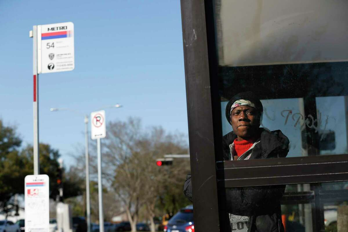 Sharon Wilson waits on the 54 bus at a stop at Scott and Bellfort on Feb. 26, 2020, in Houston. Metropolitan Transit Authority is making changes to the 54 Scott and and 56 Montrose/Airline routes as the first steps to improve 17 corridors with better bus stops, access and traffic signal timing.