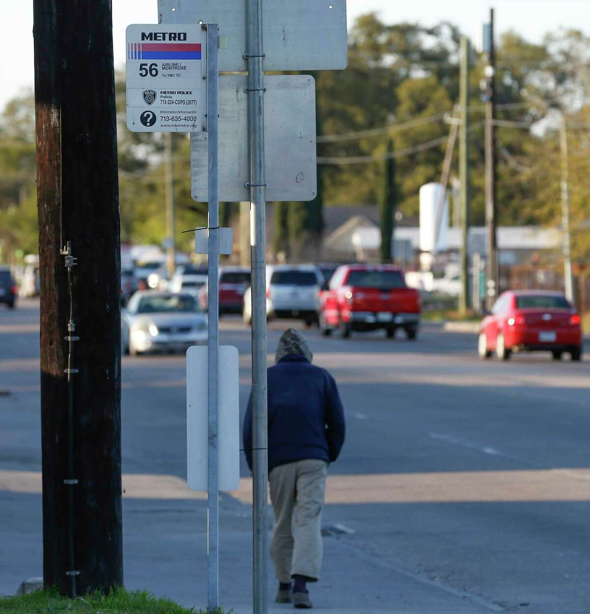 A pedestrian walks by a bus stop at Canino and Airline on Feb. 26, 2020, in Houston. Metropolitan Transit Authority is making changes to the 54 Scott and and 56 Montrose/Airline routes as the first steps to improve 17 corridors with better bus stops, access and traffic signal timing.