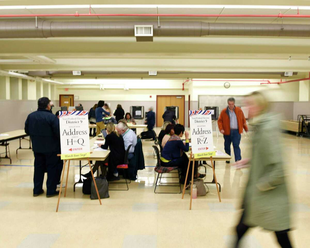 A steady turnout of voters vote at the District 9 polling center at the Eastern Greenwich Civic Center in the Glenville section of Greenwich, Conn. on Election Day, Tuesday, Nov. 6, 2018.