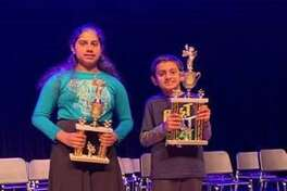 While Beckendorff Junior High eighth grader Keerthanan Krishnan, left, places as the runner-up, Wilson Elementary fourth grader Kunsh Kalra comes out champion at the Katy Independent School District Spelling Bee. Both plan to compete in the Houston Public Media Regional Spelling Bee on Saturday, March 7.