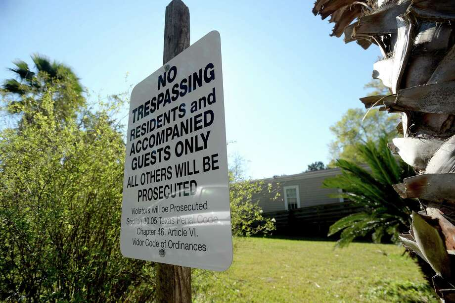 "A prominently displayed ""No Trespassing"" sign is posted at the front of a home on Weatherford St. in Vidor. The property owner, who no longer lives in the home and wanted to protect it due to incfreased criminal activity, joined the city's new trespassing program that allows police to arrest and cite trespassers when a property owner is not present. A woman was recently arrested after neighbors called about possible trespassing at the property. Police found a broken window and discovered the woman in a closet inside. Photo taken Thursday, February 27, 2020 Kim Brent/The Enterprise Photo: Kim Brent / The Enterprise / BEN"