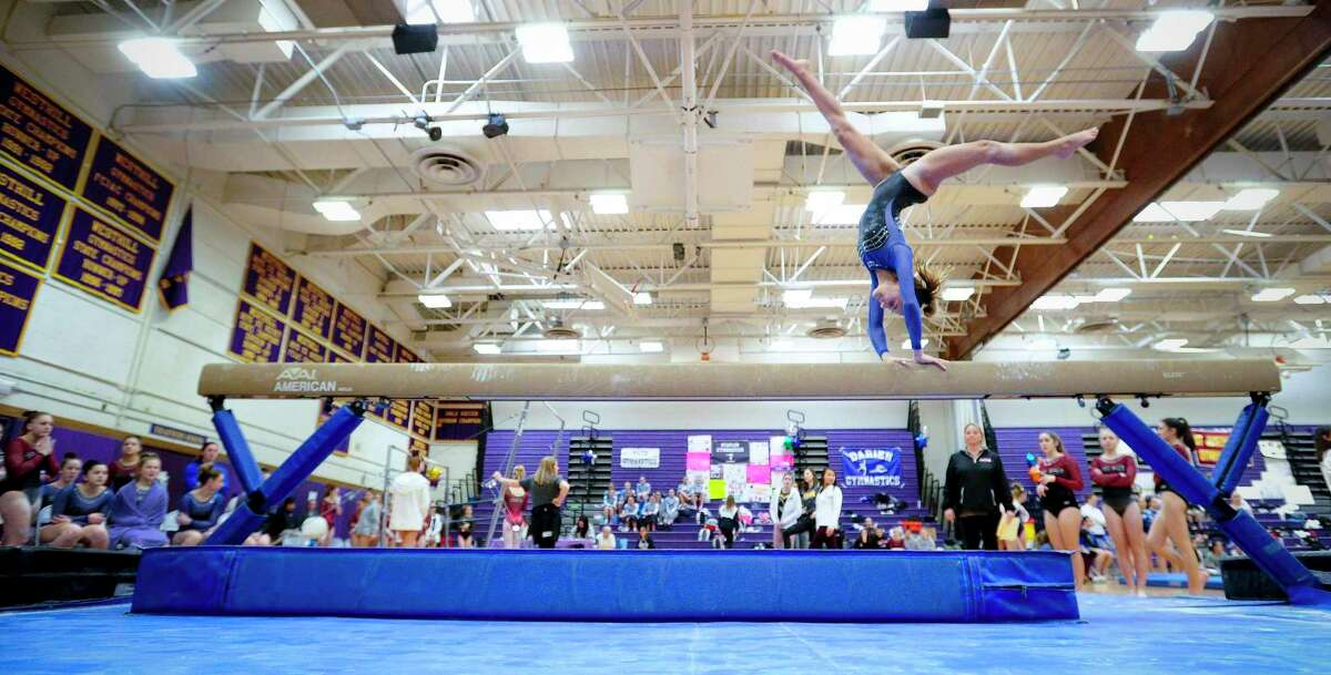 Fairfield Ludlowe's Ava Mancini competes on the beam during the Ro Carlucci FCIAC Championships for gymnastics at Westhill High School on Feb. 15, 2020 in Stamford, Connecticut. Fairfield Ludlowe won the FCIAC gymnastics championship with the Falcons' Mancini taking top individual honors in All Around.